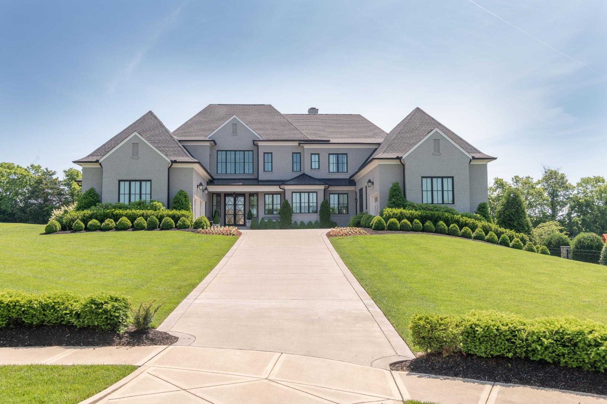 **NEW PRICE**Brilliant home in spectacular Annandale neighborhood highlights open floor plan.The gourmet kitchen has a great eat-in nook and opens to a spacious family room and striking dining room.Separated by a dramatic two sided fireplace, these rooms are bathed in natural light from an expansive moving wall system of glass doors.The Master Suite is flanked by a private Study and luxurious Master Bath. His & Hers closets as well as a stackable washer & dryer complete the Owner's Suite.(More)