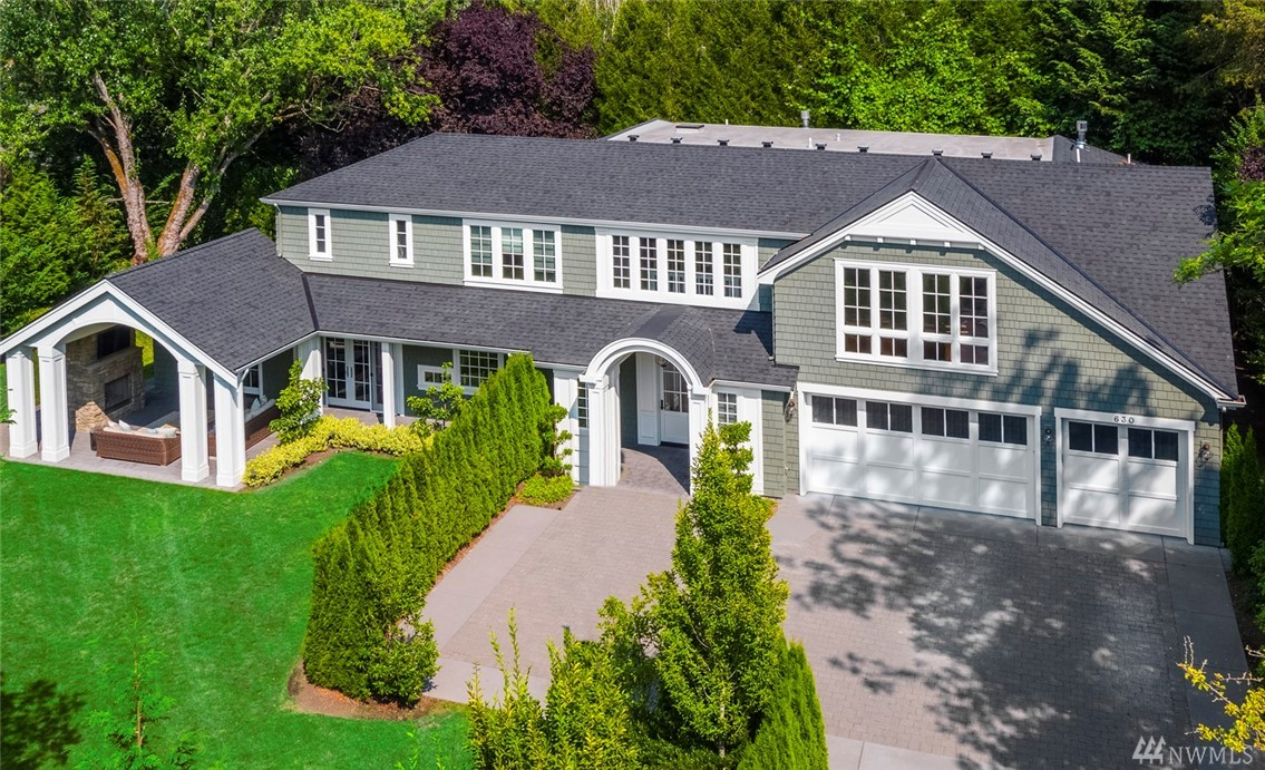 Live life inspired in this timeless classic designed home. Experience luxury in the heart of Medina. Sited on a private park-like generous one third acre. The chef's kitchen is designed for entertaining featuring commercial style appliances, expansive island and abundant gleaming white cabinetry.  This refined and well thought out home has multiple entertaining spaces: spacious great room, main floor guest suite and outdoor covered living area for year around enjoyment. Simply remarkable.