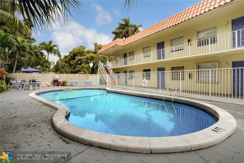 PRICE REDUCED!  Poolside second floor condo in small  26 unit complex with a great eastside LOCATION!  HOT neighborhood-- just 1/2 mile to NE 13th Street business district which has undergone a $2M streetscape renovation and is now burgeoning.  Only one mile to the entertainment district of Wilton Drive, which has also recently undergone lane reduction & major streetscape improvements.  3 miles to Las Olas, 3 Miles to world famous Ft. Lauderdale Beach, and 6 miles to FLL International Airport.  Renovated kitchen with spacious cabinets, stainless appliances and granite counters.  Great closet space includes a large walk-in. Pets okay, with combined weight not to exceed 50 lbs.  No 'agressive breeds' per association documents.  One assigned parking space and lots of guest parking.