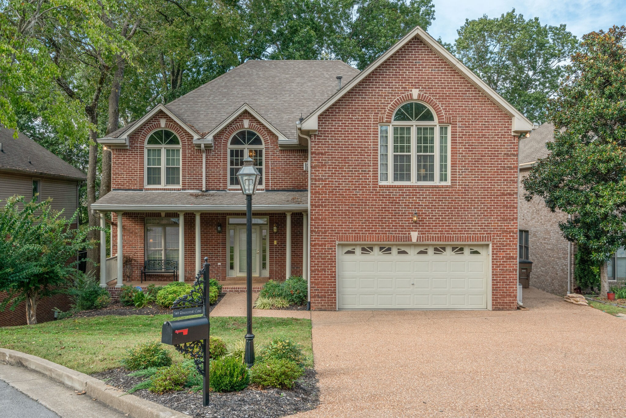 This wonderful Frank Batson home in the beautiful River Crest community has 5 bedroom/3.5 baths and plenty of space all around.  With a fireplace in the Master Bedroom, security room, in-home vacuum system, stereo & intercom system. Incredibly spacious with 14 closets, a driveway that fits up to 6 cars, a storm cellar and a very comfortable living space below great for a music studio or mother in law suite. And just minutes from Donelson Y and Stones River Greenway, you won't want to miss it!