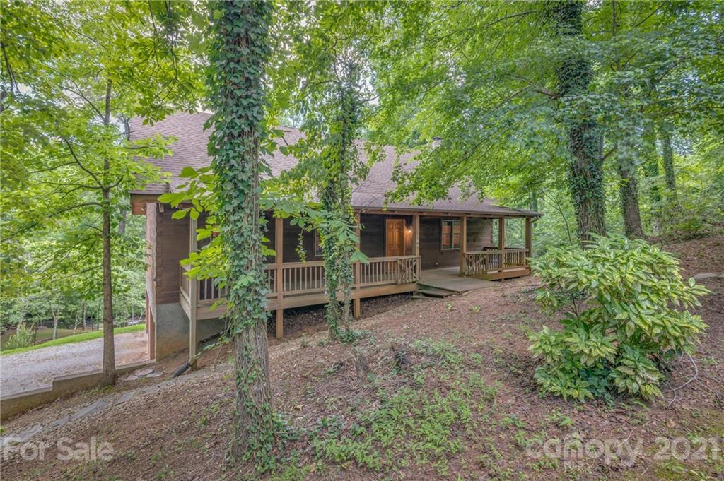 Let the river wash your cares away!  Beautiful riverfront Log home.   A private lot slopes down to your own piece of the Pacolet River. Situated on a picturesque bend in the river where the water quickens over rock outcroppings.  3 bedroom 2 baths Southland log home.  Great room w/stone FP and cathedral ceilings opens to expansive deck overlooking the river.  New carpet in bedrooms and wood floors freshly refinished. The large upstairs loft is an amazing flex space. 2 car garage basement has endless possibilities. Additional .70 acre building lot MLS 3753006 next door also available.  Desirable location in old Hunting Country.  This property was evaluated for Airbnb rental potential and income projection documents are available by request.  The previous lender has not required flood insurance as the actual residence is outside of flood zone