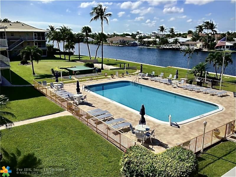 Watch the boats parade go by on the Intracoastal from your patio! Bright renovated 1 bedroom unit with beautiful Intracoastal Waterway views! Updated kitchen and bathrooms, this gem is tiled throughout, Screened in porch with a gorgeous view in quiet residential area. Large heated swimming pool, barbeque, rec room, assigned & guest parking, car wash area, bike rack, separate storage area. Three blocks from the casual Deerfield beach,    area lifestyle, walk along the boardwalk to the open air bars, restaurants and pier. Low monthly maintenance ($239) in well maintained & managed building. Lease after two years, HURRY UP!!! WONT LAST THE ONLY ONE BED FOR SALE IN THE COMPLEXE