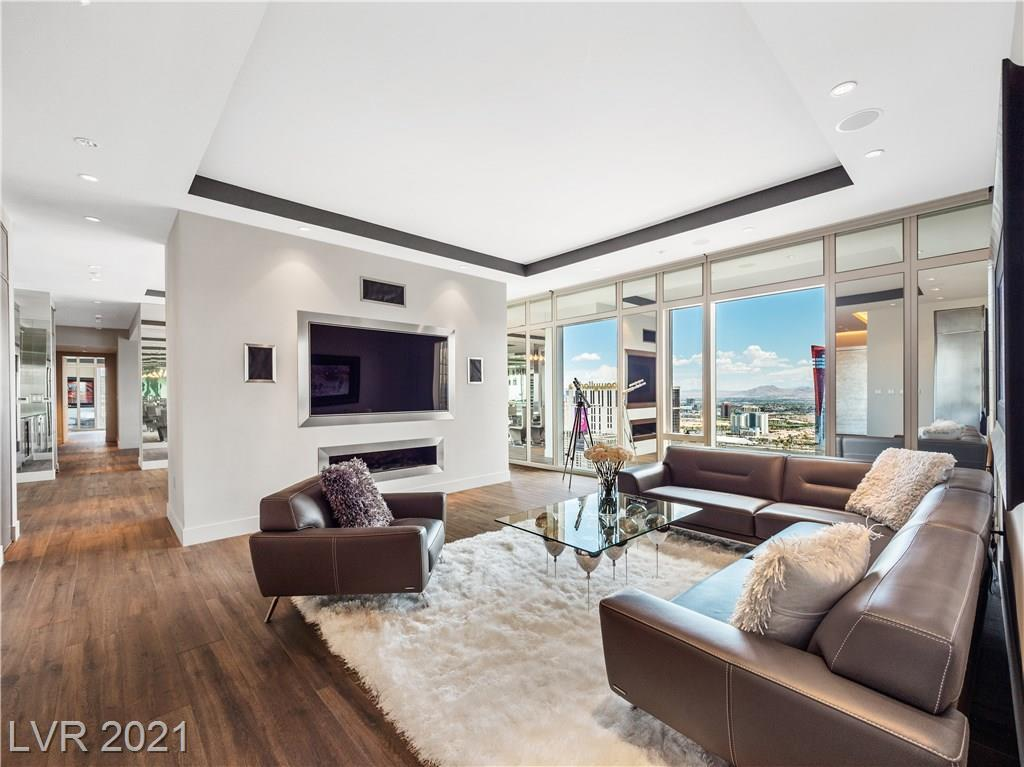 This one of a kind Waldorf Astoria residence is absolutely stunning featuring incredible custom finishes and a large open floor plan complete with dual master suites, spa-like bathrooms and modern kitchen with bar and wine fridge finished in all stainless steel. Tasteful mirrors throughout expand the space even further along with large floor to ceiling windows allowing for plenty of natural light and breathtaking views of the Las Vegas Strip.