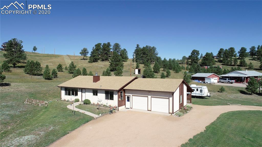 Great one level living on 2.57 Acres, with Fantastic Pikes Peak View!!! 2 Bedroom 2 Bath. Southern Exposure, Open floor plan, Wood Fireplace, with Gas starter in living room. Vaulted ceilings, Pella Wood Windows, Hot water Radiant heat, natural gas, 2 car attached garage, and an attached car port! Lots of wildlife, and you cannot beat the views from this house. Stop by and see it today.