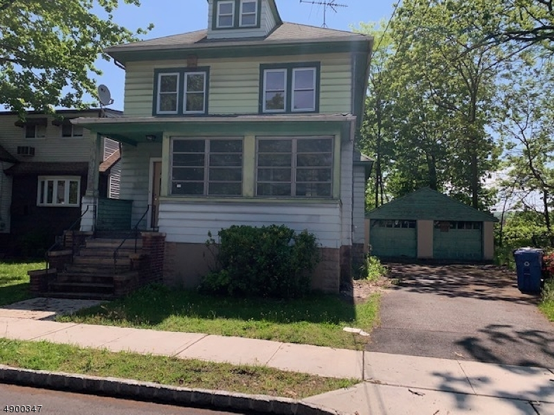4 Bedroom Colonial on Oversized Lot Features Living Room, Dining Room, Kitchen, 1.5 Bathrooms, Enclosed Porch, Unfinished Basement, Walk-Up  Attic, 2 Car Detached Garage, Large Driveway and is Located Closely to Park, Schools, Shopping & Public Transportation.