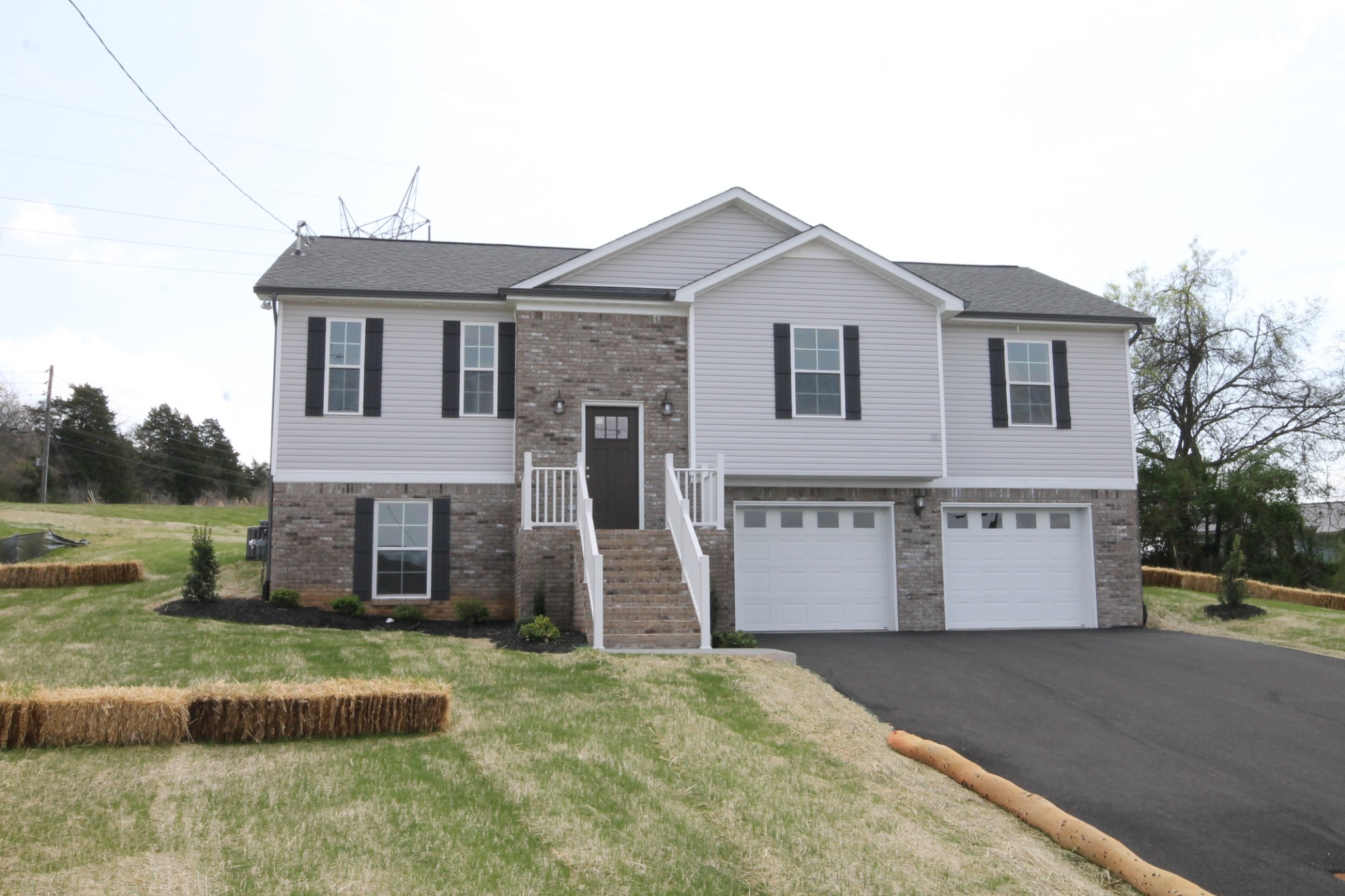 Brand New Home! 4 bedrooms plus a playroom! Your family will delight when they see this new home on a large lot near Woodard Elementary and Columbia State. Split bedroom floorplan for everyone's privacy, main level family room, lower level playroom, beautiful custom cabinets, tile bath floors, and luxury vinyl wood flooring in all living areas! 3 full baths and half acre lot! Large deck located off the kitchen is perfect for grilling and entertaining.