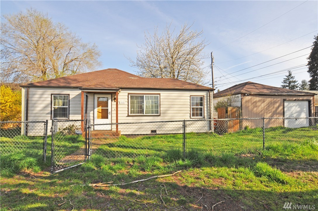 Solid Fixer in a great location, 2 bed plus a bonus and one bath, fair sized kitchen, will need TLC for sure, large yard and detached 2 car garage (one garage door), due to the \need for a roof, gutters, and some siding, cash offers only.