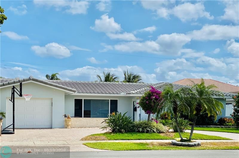 What an Amazing Warm Family Home! This One Story 3 Bedrooms, 2 Baths, One Car Garage Pool Home in desirable East Deerfield Beach. Beautiful Porcelain Floors, new Tile Roof, new Hurricane Impact Windows and Doors, new Tankless water Heater, 2017 A/C. Open Kitchen and Family Room overlooking Pool Area. Fenced Private Backyard, Pool has 3 Circles Swimming and  Spa. Brick Pavers Patio Perfect for entertaining. Enjoy Living within Walking Distance to the Beach, Shopping, and Restaurants. not Available to show Until 03/21/2020