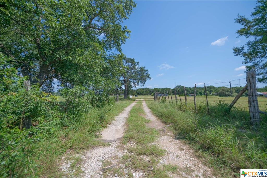 Located in the heart of Bell County, here is your little slice of heaven.  With gentle rolling hills, open and native pasture with trees, this 35.018 acres can serve for agricultural purposes or wildlife/recreational use.  This property has great highway road frontage that could benefit for a commercial business.  There are two water meters and electric.  Property will come with royalties from Lhoist North America.  This property is being sold with two connecting properties (ID 460891 0.731 acre and ID 460302 5.05 acres) for a total price of $1,050,000.  All three will be sold together and include a barn, corral and outbuildings.  Call listing agent for any questions.