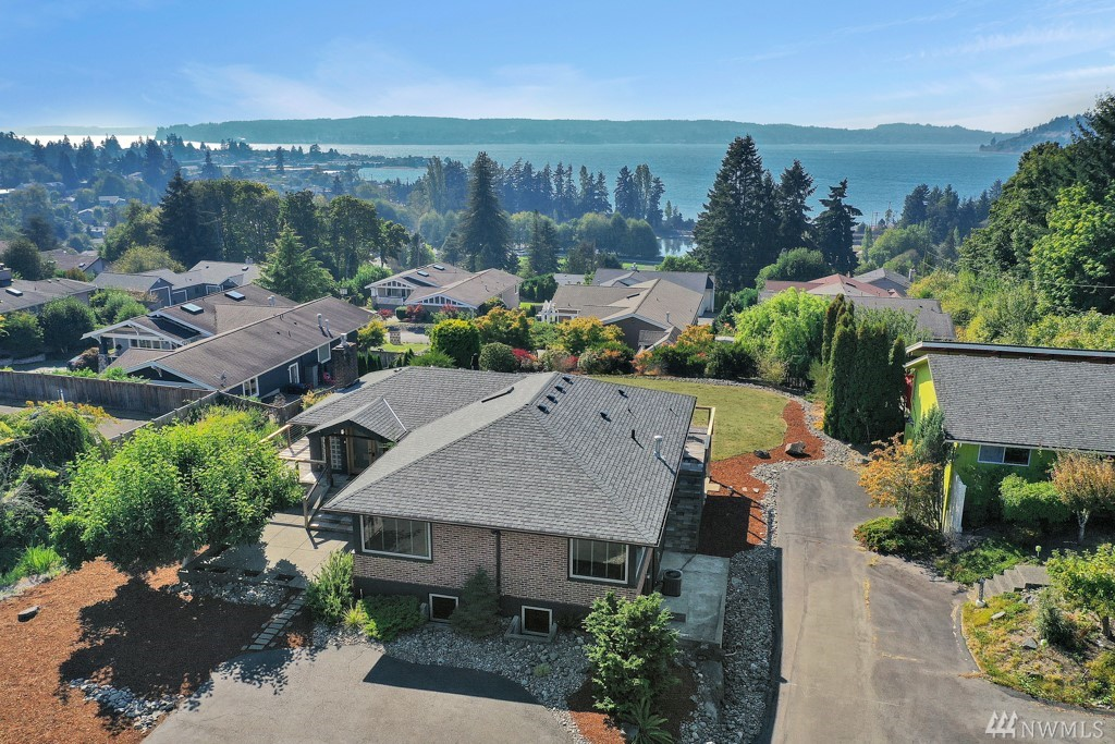 Come enjoy beautiful sunsets in this one of a kind luxurious estate w/breathtaking views of the Sound! This custom hm features 4 bdrms w/ lrg mstr suite, soaking tub, custom walk in closet, 2.25 bths, 3000 sqft of stylish living space, gourmet kitchen & appliances, french doors open to spacious deck, electric blinds, white oak hrdwds, tile & slate, specially crafted fir windows, doors & cabinets, AC, gas FP, mature landscaping on 1/2 acre w/lots of parking & private drive. Newer roof. No HOA.