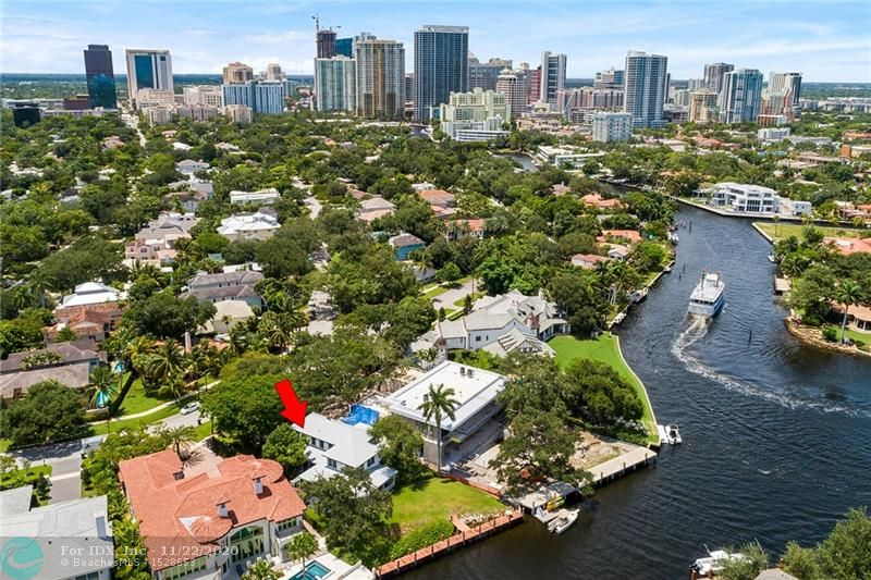 The Most Spectacular Waterfront View in the neighborhood. 100 ft dock with natural seawall on deepwater lot. Located on the mouth of the Tarpon River/New River in historic Rio Vista. Built in 1928, this 4/3 home has original hardwood floors, fireplace, and wrap around porch for perfect South Florida living. It has been owned by the same family since 1956.It is ready for complete restoration/remodel or new construction.