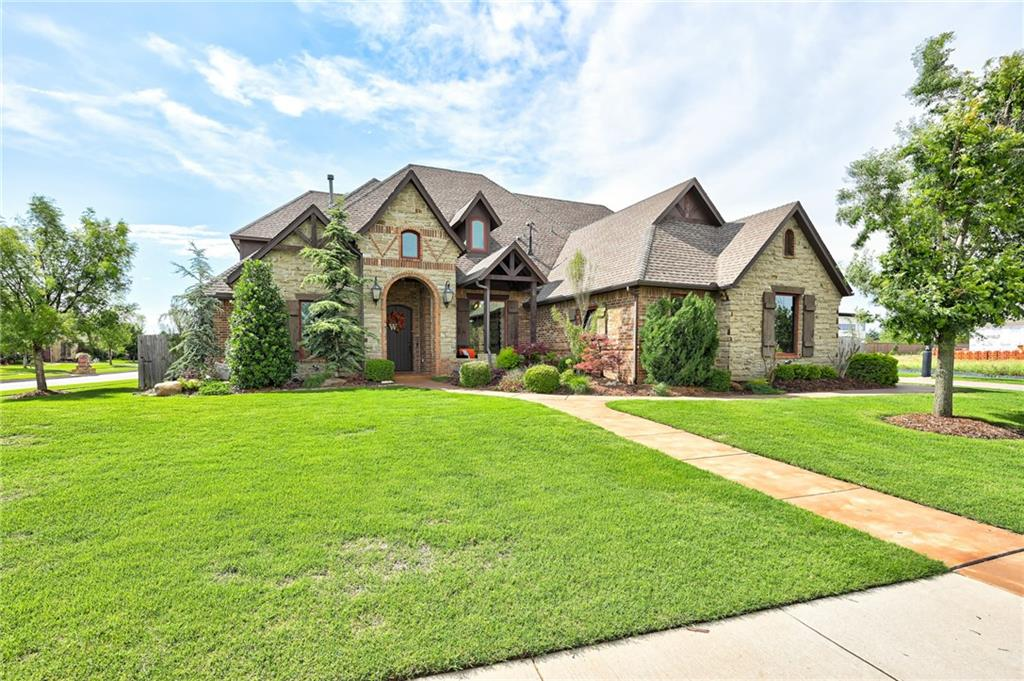Come see this amazing 5255 sq ft custom home with all of the bells & whistles! Walk in the front door to see beautiful custom woodwork throughout the entire home, large open concept kitchen with double island, Frigidaire Professional oven/range with additional auxiliary oven, 2 pantries, oversized laundry room w/ wrapping station and also connected to the master closet.  The homes boasts 5 bedrooms, 4.2 baths, bonus room, theater, exercise room, 2 attics, home security system, 2 tankless water heaters, sprinkler system, amazing storage plus so much more! Your backyard is a private oasis with large covered patio with a fireplace and outdoor kitchen, a saltwater pool and hot tub! This is an entertainers dream.  The home also has a compressed natural gas fueling station and a natural gas generator that will automatically kick on when needed.  The upstairs bedroom also has its' own bonus area that could easily be used as a mother-in-law suite that is separate and private.