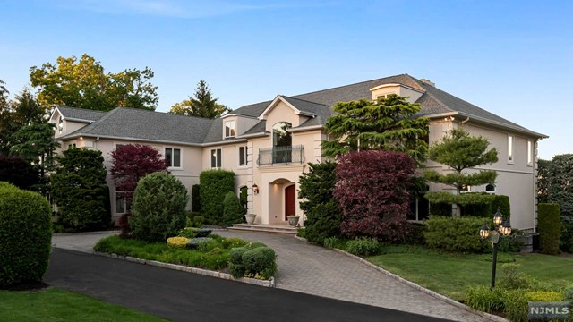 Welcome to this incredible 7 bedroom, 7 full and 1 half bath estate in the desirable Bluff section of Fort Lee, NJ with breathtaking panoramic views of the George Washington Bridge, Hudson River and New York City. This manor features approx. 8,500 sq. ft of living space on 2 floors, plus an additional finished walkout lower level of approx 3,500 sq. ft. Enter through the 2-story foyer to find formal living and dining rooms, a library, a bedroom suite, mud room, laundry room, commercial grade Chef's kitchen with breakfast area and family room. The stunning great room with fireplace features floor-to-ceiling windows and high ceilings making this room bright and sunny with exquisite views and access to the patio overlooking the lush landscaped grounds. Second floor is complete with a large master suite with 2 walk-in closets and luxurious master bath, as well as 2 additional bedroom suites, 2 more bedrooms, a full bath and another family room.