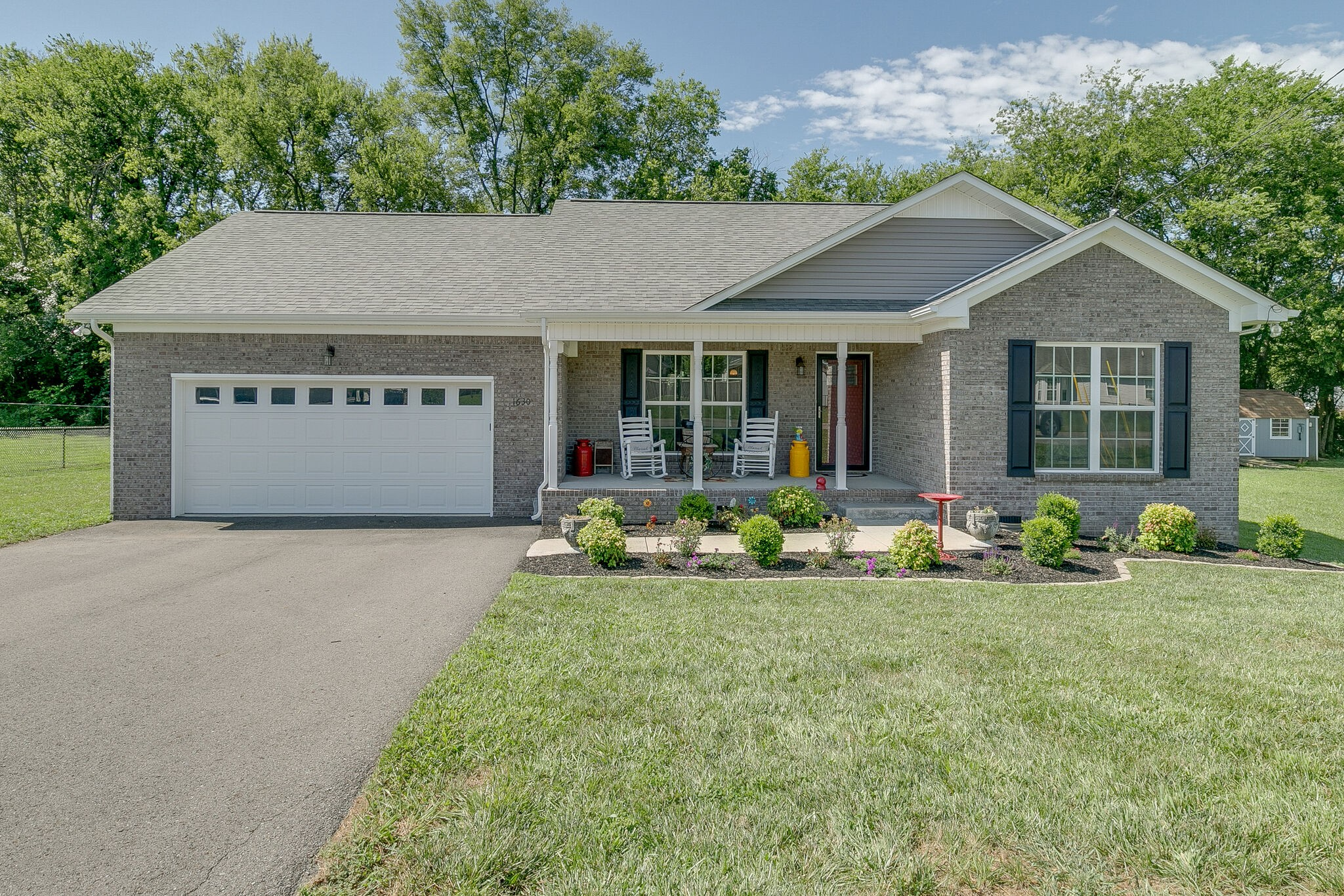 AS GOOD AS NEW~FALL IN LOVE WITH THIS 2 YR OLD HOME WITH A OPEN FLOOR PLAN~GRAY PAINT~WHITE KITCHEN CABINETS~STAINLESS APPLIANCES~SHIPLAP BACKSPLASH~LARGER LIVING ROOM~FENCED YARD~GARAGE HAS GAS HEAT INSTALLED~INSULATED GARAGE DOORS~MOVE IN READY.