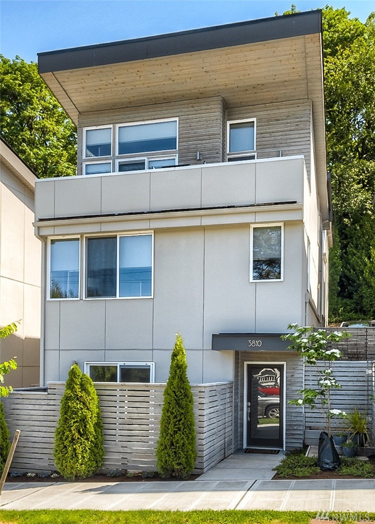 Rare find in this meticulously maintained, spacious modern home. First resale in fantastic neighborhood near shops, restaurants and Alki Beach. Hop on water taxi for an 8 min ride to DT Seattle! Features a well appointed kitchen, an abundance of quartz & tile, white oak floors and tall ceilings on all levels. Spectacular view master 2/spa bath, walk-in closet and private deck overlooking harbor and Elliott bay. Parking in rear, motorized blinds, full size W/D, fenced patio & huge storage area.