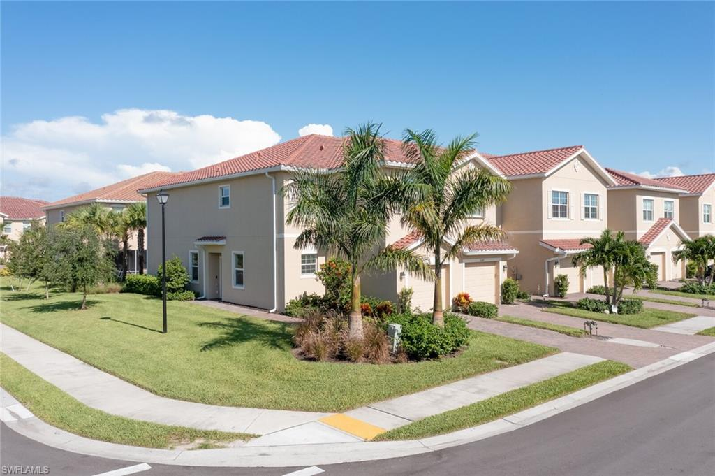 Located perfectly within The Ranch at Orange Blossom, this immaculate END-UNIT townhome built in 2019 has 3 bedrooms, 2.5 baths, 1 car garage, and is a smart home featuring ring video doorbell, thermostat, garage door and lighting that can be controlled from your smart phone. 1,756 sq. ft of living space that has been tastefully upgraded with white kitchen cabinets, stainless steel appliances, gorgeous backsplash, half bath vanity and custom laundry room. Screened-in lanai offers additional storage and is just off the living room which is perfect for entertaining or having your morning coffee. Wonderful grass area right outside the lanai to walk your dog! Large Master with sitting area, laundry, and two bedrooms and bath just down the hall on 2nd level.  Orange Blossom Ranch provides everything you need to enjoy the Florida lifestyle including 2 resort-style pools, 2 spas, basketball courts, tennis courts, playgrounds, splash pads, social clubhouse, exercise room with children's playroom, sand volleyball, fishing pier, walking and bike paths, full catering kitchen & bar, and so much more. Orange Blossom Ranch is located near the new Collier County Regional Park and top rated schools.