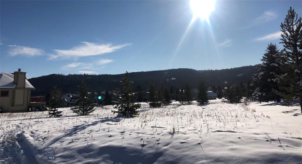Build your dream home on this lot located in Big Sky's Meadow Village.