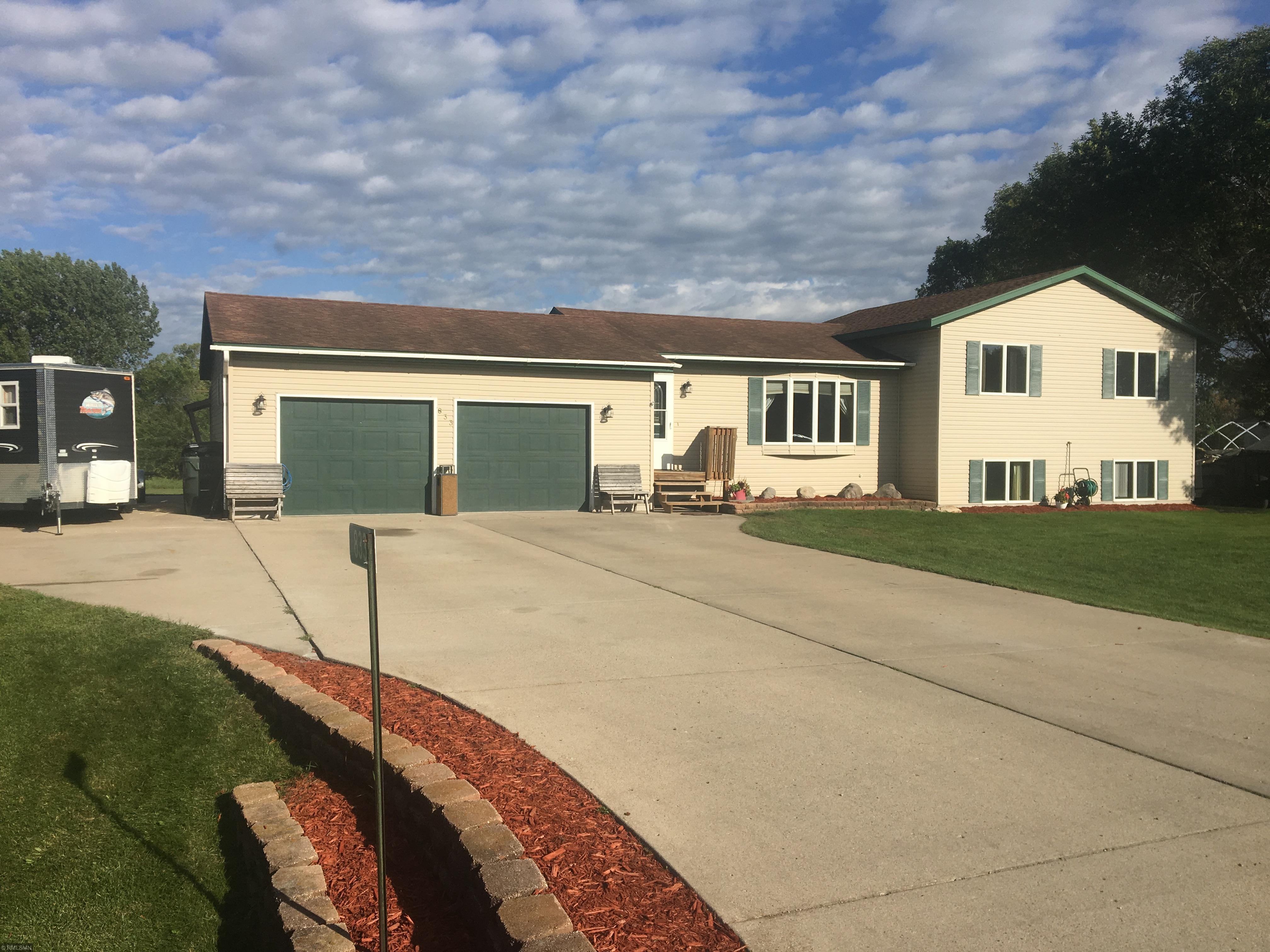 Quiet Setting on dead end road.  5 BR 2 bath large yard.  LR and Two Family Rooms
