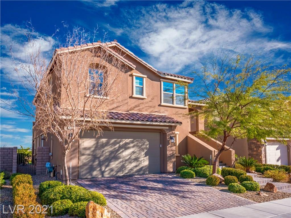 Views, views, views! Hard to find & one-of-a-kind split level home in gated Summerlin West community w/ the most breathtaking scenery from main living area, balcony AND rooftop deck. Located in lower level is a Media room, 3/4 Bath, laundry room & spacious Master suite w/ custom walk-in closet, Bathroom w/ tub & shower. Upper level is main living area, 2 BR w/ new carpet, office w/ closet (poss. 4th BR) & kitchen. TONS of upgrades throughout - tankless water heater, water softener, built-in surround sound, custom built-in media center w/ projector & screen, quartz countertops in kitchen, new paint throughout, Nest doorbell integrated w/ Google Home, epoxy garage floor & insulated garage door, ceramic flooring, Energy Efficient windows throughout, & more! Rooftop deck furniture stay w/ home. Easy to maintain backyard w/ synthetic grass & separate doggy run. Near Downtown Summerlin, community parks & trails. Zoned for 5 star Vassiladis ES. This entertainers dream home WILL NOT last long!