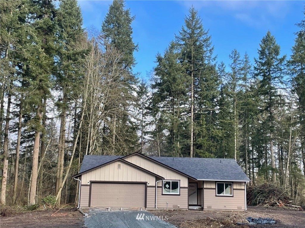 New Rambler on 5 Secluded Level acres Home site back off road. Great room concept!  Kitchen with stainless appliance and Engineered hardwood floor entry through Kitchen and Family room. Family room with vaulted ceiling and fan and mini split A/C. Master with walk-in closet and own bath. Plenty of room for RV, toys etc..