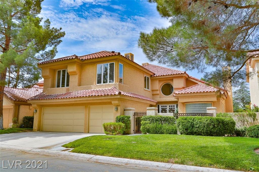 This stately 4 BDRM, 4 BA residence overlooks the prestigious Spanish Trail Golf Course. Panoramic views of lake, waterfall, mountains & sunsets. Minutes to Las Vegas Strip. Grand marble foyer with dramatic spiral staircase. 4134 sq.ft. Separate den with wet bar. 3 fireplaces, vaulted ceilings. Granite island kitchen with Viking & Sub Zero with pantry & nook. Separate family room w/surround sound. Built-in entertainment center. 1 bed down w/full bath + guest bath. Large laundry rm w/ sink. 3 car garage. Loft. Spacious primary bed w/built-ins &