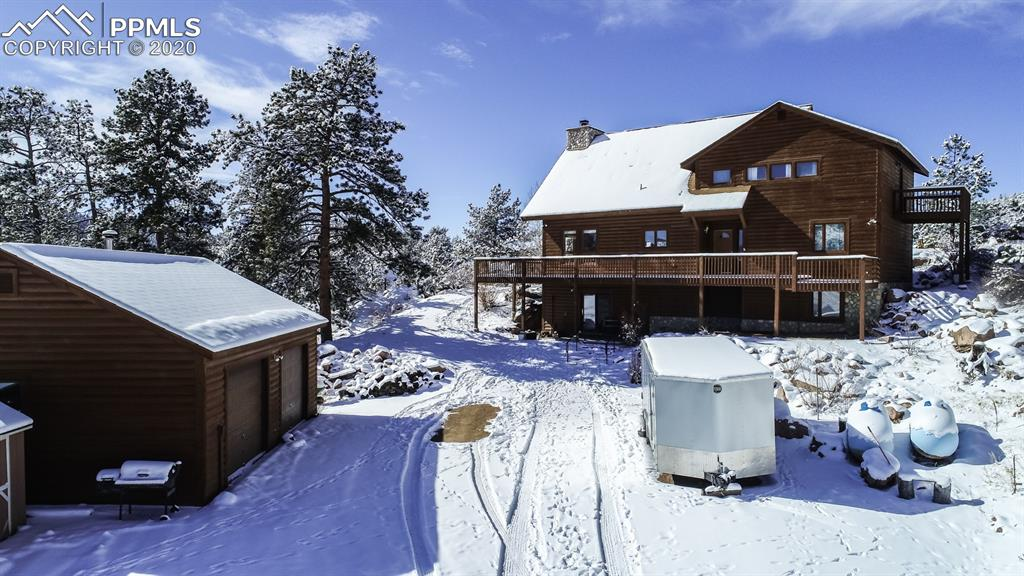 STUNNING Custom Log home, with fantastic views of Mt. Pishga and the valley of the property 5.72 Acres Main level open concept, very cozy with two wood fireplaces, one on the main level, and one in the basement. Very open with vaulted beamed ceilings, walk out to enjoy the valley views from the dining room. Large kitchen with oak cabinets, all stainless steal appliances included. All new Granite Counter tops throughout the home. Main Level laundry facilities washer, and dryer also included.
