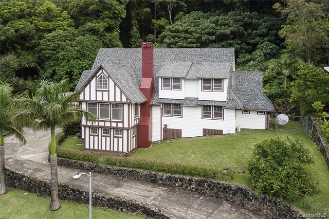 Discover an exquisite traditional castle in Manoa.   Forest behid the property transitions to manicured classic home has view.  Large living room with enclosed lanai, also outside kitchen deck can enjoy your relaxation time.  Quiet cul-de-sac in a well established neighborhood.
