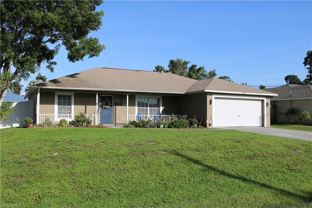 ADORABLE SAN CARLOS PARK HOME!  New Landscape!  New Fenced in yard! New Irrigation!  Stunning look from out side in.  A front porch entry and a fenced private back yard with Fire pit area.  You will love and enjoy the outdoors!  Inside is just a quaint. A large comfortable open living area that is perfect for a family and for entertaining! From the soaring ceilings, to the beautiful floors, and the neutral paint, this home will welcome you. The living area is extremely spacious, the dining room has a slider leading to the HUGE lanai.   The  island kitchen has modern backsplash and quality BOSH and Whirlpool appliances.The Master and Master bath are on one side of this home and the other bedrooms are split for privacy. This beautiful master bedroom, with en suite bath, and walk in closet will offer plenty of privacy.   The  two guest beds and bath offer room for guest, family or additional living space.  The yard is huge, with more than enough room for a pool, A Big Lanai with TV area for game night! The private yard has a great firepit for cooler evenings with family and to friends!  A must see and priced to sell quickly!  Flexible closing.