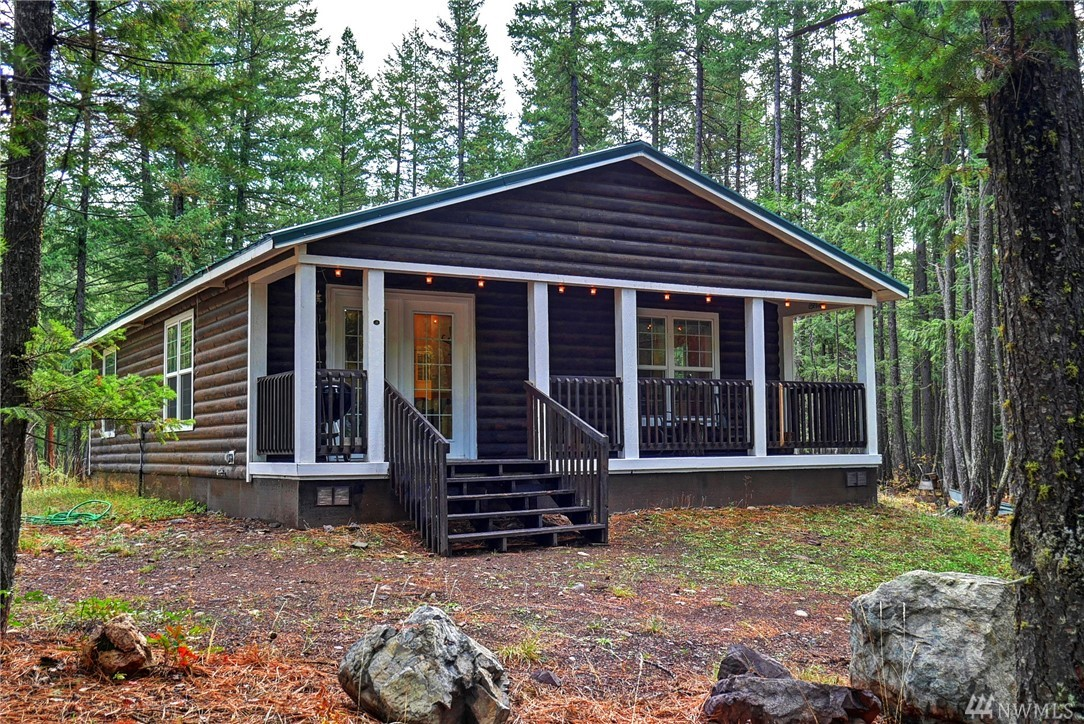 Super cute M.H.Cabin in Mazama/Lost River area on a level treed lot! 2007 Manufactured Home is mint condition. Like new, Log sided exterior, wood deck covered porch and railing. Shy half Acre Lot allows room for a garage outbuilding. 2 Bedroom & 1 Bath. 972 square feet. Covered deck to front door entrance (162 sf). Community water, on-site septic system.   Lost River Airport Tracts, Mazama. Seller visits regularly.