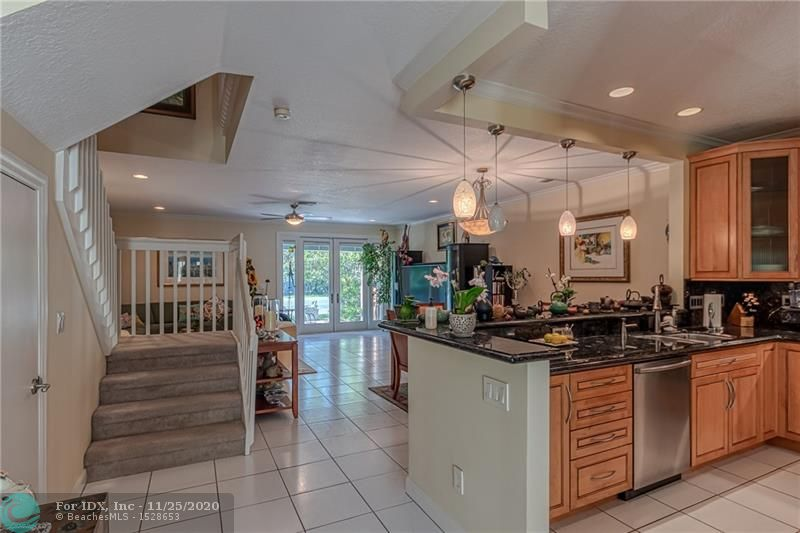 Downtown Fort Lauderdale!  Beautiful Townhome located in Tarpon River area.  A rare and unique gated and secure development that located on the New River with only19 total units.  HOA covers building, roof, all exterior maintenance, common grounds, pool, tennis court, water, sewer,  and trash removal.  Grounds and complex beautifully maintained.  Updated kitchen and baths.  Hurricane impact windows and doors.  1.5 car air conditioned garage, large patio.  Top of the line construction.  I bedroom used as an office with custom built-ins.  Same owner since newly constructed with periodic updates.  Close to Riverwalk, Las Olas, Performing Arts and all that Fort Lauderdale has to offer.  Do not miss this opportunity to live in one the the most desirable areas in S Florida.