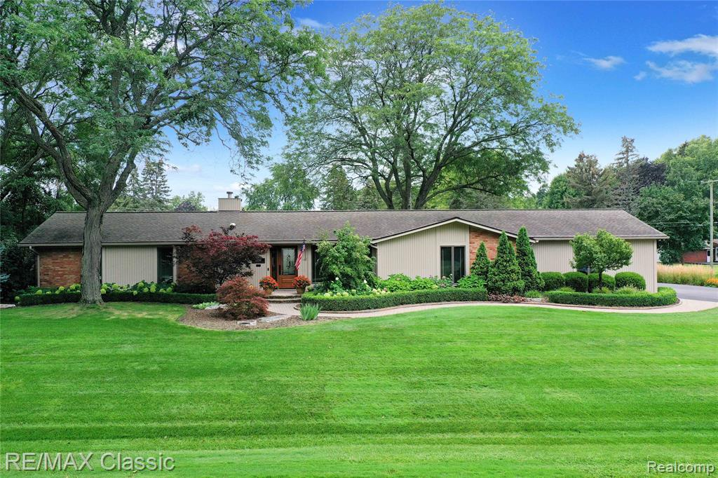 Outstanding Bloomfield Township ranch w/ attention to detail on half acre. Kitchen completely remodeled in 2018 w/ Custom Designed Cabinetry, Granite Counter tops & High End Stainless Steel Appliances. Bosch Dishwasher & Dual Fuel Range/Stove (Gas Cooktop/Electric Convection Oven).  Zephyr range exhaust hood. Open floor plan for those who love to entertain. Living Room, Dining Room, Kitchen, Library, Hallways have Engineered Hardwood Hand Scraped Hickory Flooring & Recessed Lighting. Anderson Windows & Master Bedroom door wall.  Solatube Skylights. New 96% efficient furnace & A/C in 2018. Underground utilities. New GAF shingle roof in 2010. Master Bedroom En-suite features large walk in closet 12x9 w/ California Closet system, Master Bath, & Access to outdoor seating area. Lots of Storage in garage, storage room, laundry room, garage entry hallway. Lovely yard professionally landscaped, patios, driveway, paver walkway, retaining wall & So Much More! 3rd Bedroom/Library has no closet.