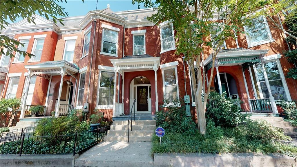 This stunning home was built in 1895, renovated to total perfection, and located in historic Adams Row of Church Hill, several blocks from St. John's Church. It boasts 11 ft ceilings, 100 year old heart pine floors, all new plumbing and electrical systems, and a 2-zone HVAC system. It further features original functioning pocket doors, 5 fireplaces and grand windows. It offers an enchanting layout on the main level with a living room/parlor flowing into the family room and dining room with a jaw dropping view of of the farmhouse kitchen,offering a robust island with bar-height seating, wainscoting, stainless steel appliances, a pot filler, ample cabinetry with soft close doors and drawers, and beautiful quartz countertops. Enjoy the unique private deck accessible from the kitchen and family room. The owner's suite is located upstairs and offers a fireplace, grand windows, ceiling fan, recessed lighting, and a spa-like en-suite bathroom featuring granite, ceramic tile, a claw footed tub and much more! There are 2 additional bedrooms and a full bath on the second floor. The fenced rear offers private off street parking where the patio and courtyard awaits. Tax credits available!