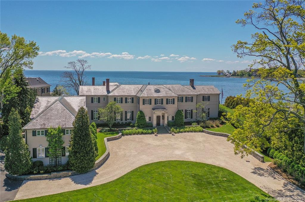 Spectacular builder's own custom waterfront home on private Rock Point Road off Pequot Avenue in historic Southport Village. Magnificent views of Long Island Sound from all major rooms in this 11,000+ square foot home. Beautiful pool and pool house look toward Beachside Avenue and the Manhattan skyline in the distance. Walk to the beach, train, restaurants, and shops. Waterfront living at it's very finest. 1 hour to NYC.