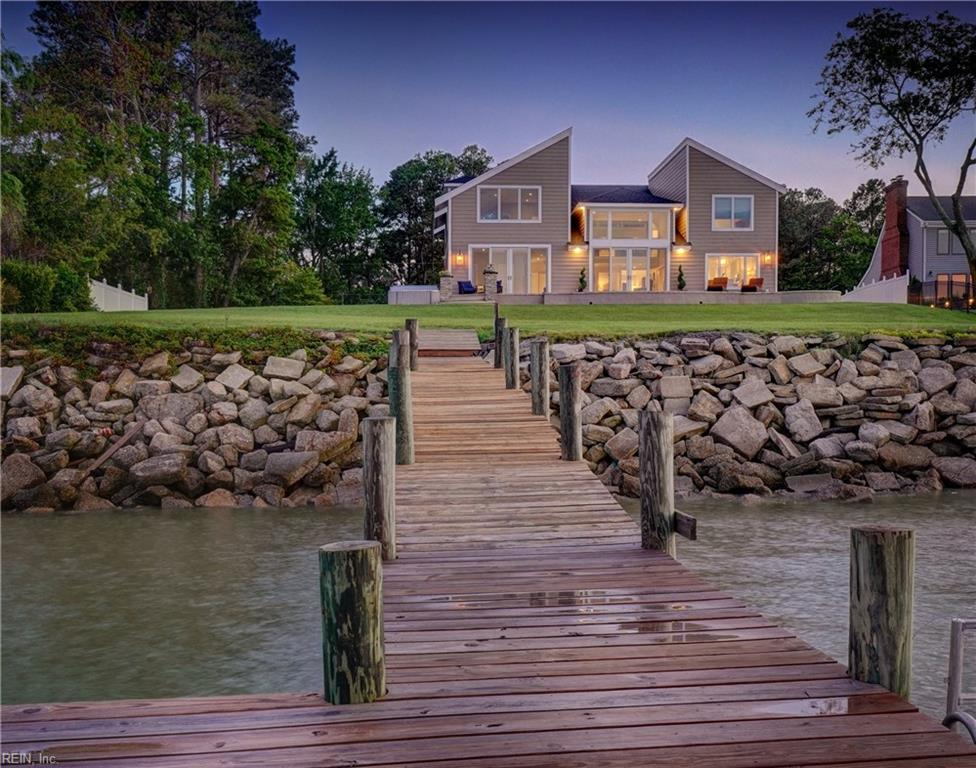 Best panoramic waterfront view in Hampton Roads! Luxury living on the James River in Barrell Point Estates. This home was completely remodeled and rebuilt in 2019 to create the best waterfront living experience with design purpose to take advantage of this Million Dollar view. Stamped concrete design deck, house exterior constructed of stone, Hardy Plank and PVC for maintenance free living. LED Lights throughout, remote solar shades, Concrete side boat pad, dock with 8,000 pound boat lift with remote, Multi zone irrigation system with rain sensor, generator hookup. All Anderson waterfront window and French door slider package and DogWatch invisible fence. Layout designed to take in the view from every single room. Large Multi-purpose room or could serve as 5th bedroom & 2nd living room upstairs that could serve as a mother-in-law suite. Temperature controlled 3 Car garage. Garage not included in square footage. City Tax records are off due to completion of home in 2020.