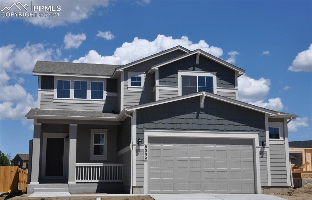 "Ready in August. The Meadow 2-story plan with 2 car extended garage in Indigo Ranch. 4 bedroom, 3.5 bath home. Kitchen features white maple cabinets with 42"" uppers and pewter glaze. Granite counters, stainless appliances and gas cook top.  Air conditioning. Gas fireplace in great room. Gas line to range. Finished basement includes 1ft taller ceilings plus 1 bedroom, 1 bath and large recreation room. Exterior living includes covered patio."