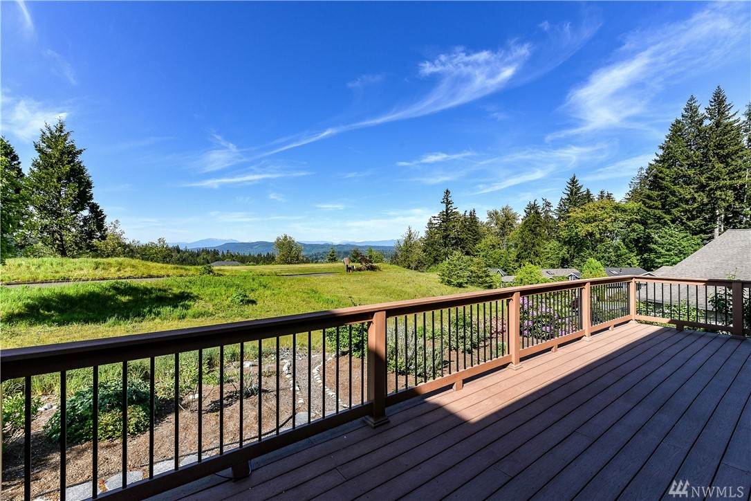 Sited on the 16h hole in Trilogy, you'll find this exquisite Maple plan home offering unparalleled 180* golf course and mountain views. Enjoy contemporary, high-end finishes, a flexible floor plan & walls of windows. Tranquil owner's suite with spa-like bath & walk-in closet w/built-ins. Cherry cabinets topped w/granite. Hrdwd floors thru-out. Custom media credenza and serving buffet. A/C. Spacious, sunny BBQ deck. Full sized 3 car garage + extended driveway. Superb location close to the club.