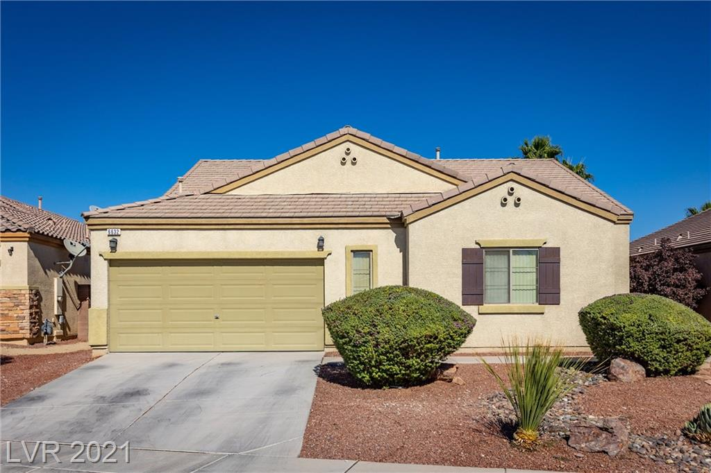 Stunning single-story home located in N. Las Vegas. Home features 2,361 sq. ft., (210 square meters), 3 bedrooms, 3 baths, 2 car garage, a spacious dining room, and a den/office that can be converted to a 4th bedroom.  Upon entering you will find vaulted ceilings, an inviting family room, and a beautifully updated kitchen w/ enhanced white cabinets, backsplash, recessed lighting, Samsung stainless steel appliances, a walk-in pantry, breakfast bar/island combination, and granite countertops.  The primary suite is on the separate end of the home with a walk-in closet & the primary bathroom offers a garden tub and separate shower.  The two other bedrooms offer a jack and jill bathroom.  The home has been recently updated with wood plank tile floors.  The backyard is sure to impress with a covered patio, pavers, a fire pit, rose garden, artificial turf, & it backs to a walking path. The convenient location is close to the VA Hospital, Nellis Air Force Base, parks, dining, & shopping.