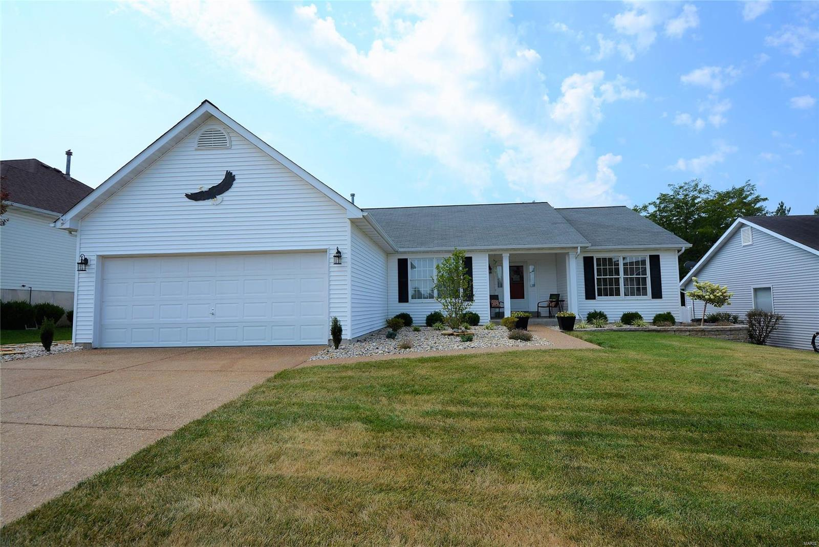 WELCOME HOME to this Fabulously updated, MOVE-IN-READY 3BR 2BTH great rm ranch w/1800+SF in the desirable Golf Club of Wentzville. Nestled on over a quarter acre fenced lvl lot this home has beautiful curb appeal w/vinyl front, lush landscaping & 2 car garage. Walking in you'll find an open floor plan w/the dining rm & spacious vaulted great rm. You'll LOVE the updated eat-in kitchen w/custom white cabinetry, granite countertops, tile backsplash, bkft bar, all new SS appliances & bkft rm w/slider to the new 14'x28' composite deck perfect for morning coffee & outdoor enjoyment. The master suite offers a luxurious updated full BTH w/ dbl sink granite vanity, soaking tub & sep shower. 2 add'l BR, full bth & laundry complete the main. Other features include fresh neutral paint, newer laminate & carpet flooring, newer hot water heater, custom designed blinds & so much more! Great location w/easy access to major hwys, top rated Wentzville School District, shopping & restaurants. A MUST SEE!