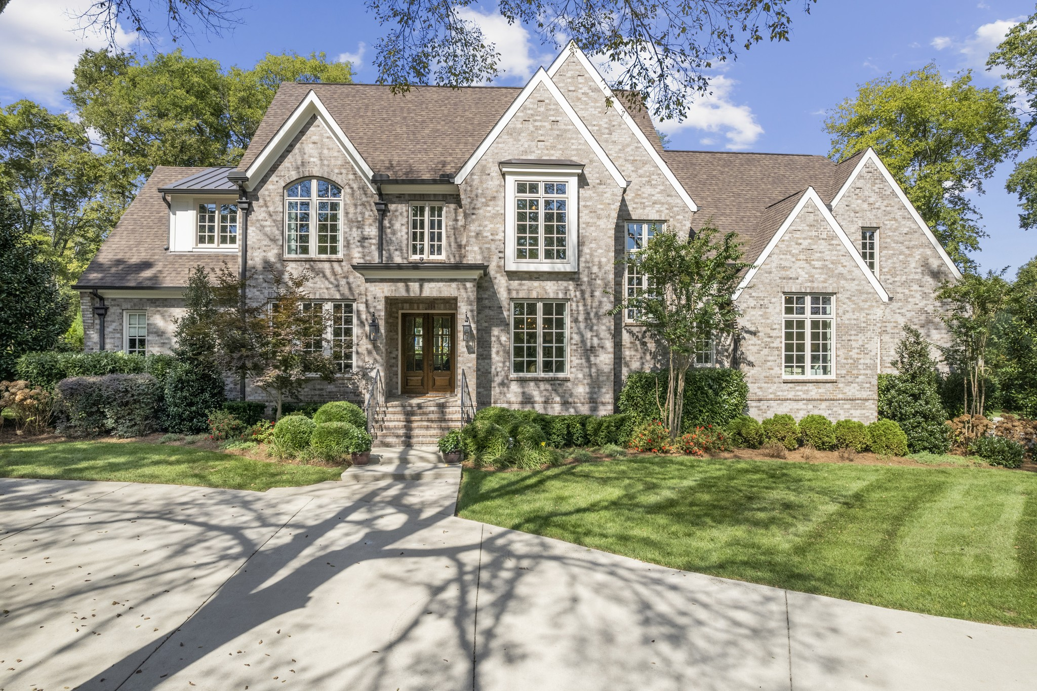 Exquisite Oak Hill Home. 1+ acres-Gorgeous Lot w/ Mature Trees. Hardwood Floors line the Main Level. 10' Ceilings. Chef's Kitchen: Gas Range, Double Ovens, Large Walk-in Pantry. Main Level Primary Bedroom Suite. Primary Bath w/ Htd Flrs, Soaking Tub, Walk-in Shower, & His & Her Closets. Guest Suite on Main Level. Wet Bar. 3 Bedrooms up w/ En Suite Baths. Spacious Rec Room. Office Up. Covered Back Patio w/ FP & Grilling Station. 4-Car Garage + Plentiful Parking. Serenity in the Heart of the City