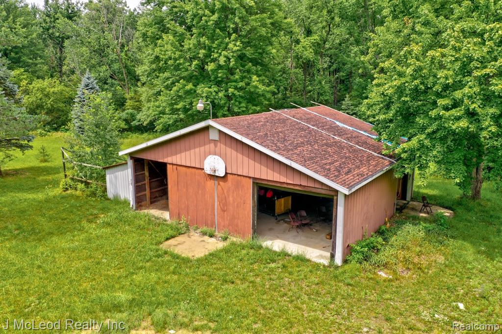 Great building spot with 10 acres, well, septic, electric, lp gas and pole barn! Everything is there and ready for you to build your dream home on! Or bring your camper and hook up for a hunting getaway! Lots of wildlife on this piece of land. The possibilities are endless. The septic is rated for a 3 bedroom home. Well was inspected and passed in 2018. There is a 26x40 concrete slab where existing home was removed from. Pole Barn is 30x40 with 220 (not currently connected) and both front and side doors. Mature trees throughout with sandy soil. **Green Friendly for grow operations** Perfect for just what you're looking for! Call today
