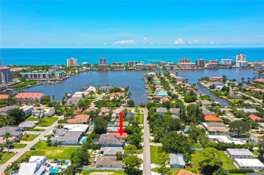 Location! One of the Best avenues in Naples Park on the 500 block! Just Across From The Beautiful Vanderbilt Lagoon and a Short Walk To Vanderbilt Beach. Features include updated gourmet appliances, granite countertops, imported Travertine and Marble flooring, 3 bedrooms + Den, 2 Full bathrooms, Toto Bidet Toilet, Jetted master tub, New windows installed in 2015, New Air Conditioning installed in 2016, Custom Window-Treatments, Concrete Block and a Stucco Key West Style Home with a Metal Roof and Brick Paver Entry. This home is also Fully Fenced and Gated with a state of the art security system that includes hurricane shutters with a Private Backyard and Southern Exposure and offers plenty of room for a Pool. This home is so large that the rear living quarters could be used for a separate in-law suit to come and go as they wish if desired, complete with a separate kitchen, dining and living areas! This home is also conveniently located close to great shopping and dining such as the Strada at Mercato, Whole Foods, Trader Joes and Water Side Shops and just a short drive to Old Naples and so much more! Don't Miss This Opportunity to live close to some of the best beaches in Naples!