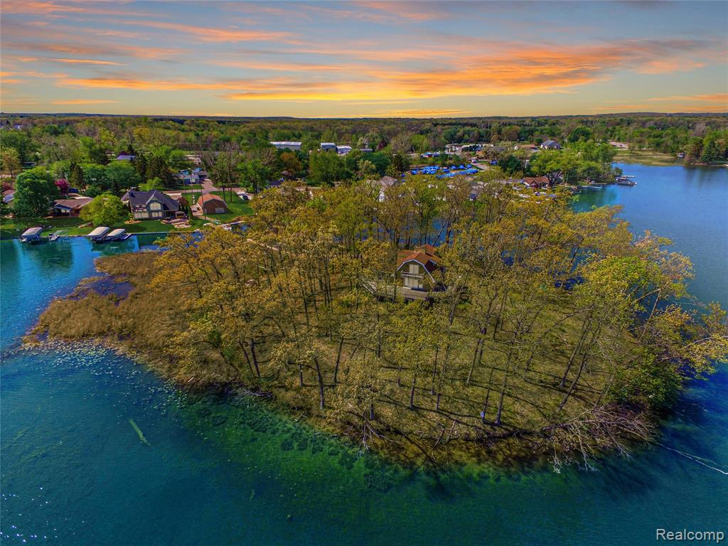 Open your eyes to all of the endless opportunities this unique property has to offer! If you have been dreaming of a small-town escape without the 'up-north' drive then the time is NOW - this private island can be yours! A gorgeous 967 ft of water frontage on All Sports Lobdell Lake with access to Bennett & Hoisington Lakes. 105 ft of water frontage on Whitehead Drive with an Outbuilding that can be reimagined into one of the popular Barndominiums with some simple ideas from Chip & Joanna Gaines. Live on the main land & create an Airbnb with the island cottage that has panoramic views & 862 ft of frontage. Enjoy a boat ride to 2 restaurants, grab pizza and ice cream on the water from the party store or enjoy the fireworks in the summer & chili cook-off on your snowmobile in the winter. Bring your passions to life with a once in a lifetime opportunity to own this piece of heaven in Linden, Michigan.