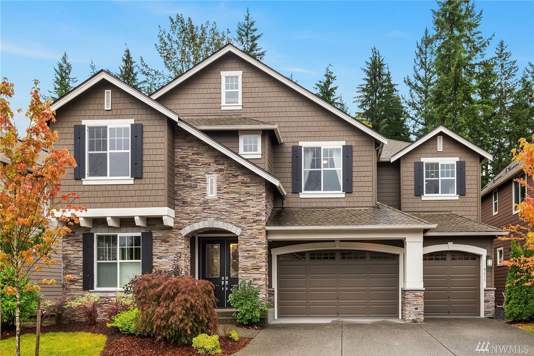 The extremely sought after Edgewater plan from Murray Franklyn in the popular Deveron neighborhood in Redmond Ridge East. Dramatic two story family and dining rooms featuring wall of windows looking out to permanent open for privacy. Over $117,000 in upgrades including custom closets, Air Conditioning, quartz countertops, built in desks in den/office. Desirable East facing home with sunny backyard with synthetic turf for year around play. Main floor guest suite and 3 car side by side garage.