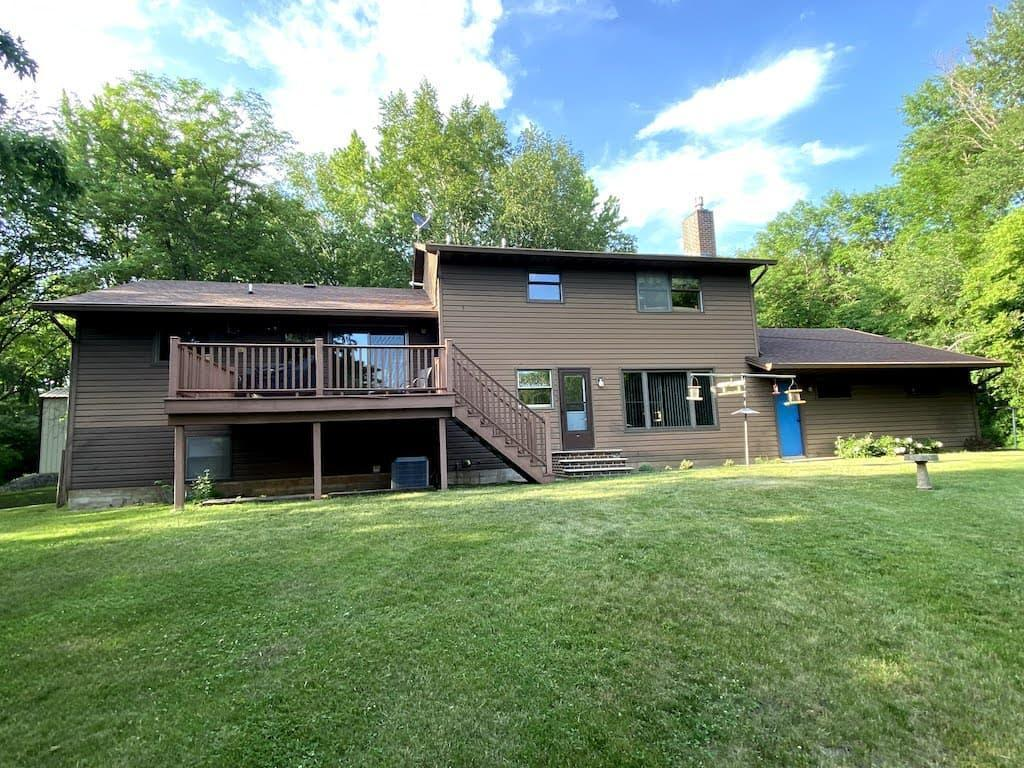 Secluded Country Hideaway! One owner 4 bedroom 2 bath custom built multi-level home located on 5+ acres near the golf course. Home features large eat in kitchen, dining room, sunken living room, huge family room with gas fireplace, master bedroom with walk through bath, 3 additional bedrooms, lower level rec room, large laundry/storage room plus a finished room with separate outside entrance (previously used as beauty salon). Additional features: large attached finished 2 stall garage, 24x26 insulated workshop, 30x48 pole building with concrete floor, 14x40 pole building, blacktop drive, maintenance free deck, steel siding, dual fuel, central air and much much more.