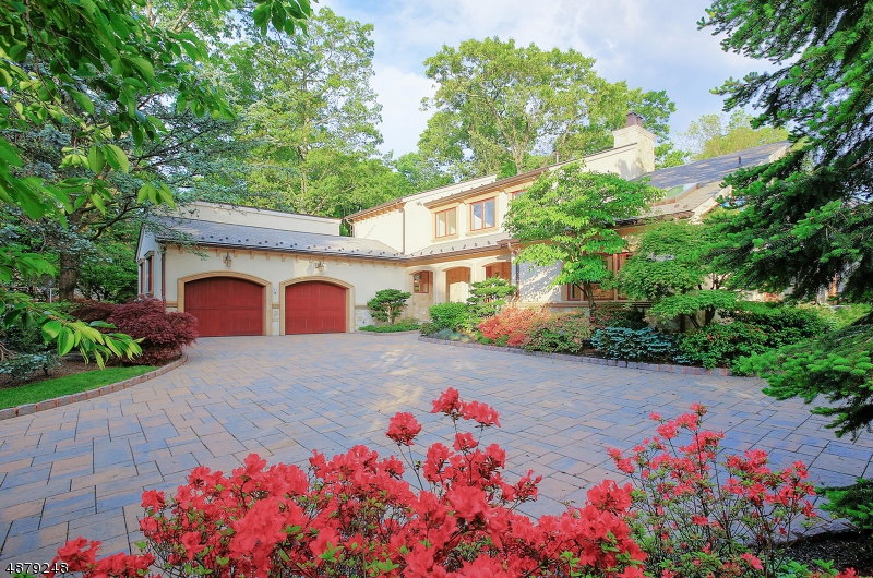 Gorgeous custom home is one of the most spectacular and unique residential homes in Warren.  Features include full house generator, custom stone walls,Koi Pond, Specimen plantings, terraces, Pergola, outdoor kitchen with Lynx appliances, bar area with Sun bright TV.  A 400,000 BTU fire pit, Epoxy flooring and heaters in all 5 garages.  Radiant heat in driveway and all pathways. Synthetic slate roof with cooper roofing in Sunroom and patio. Beautiful art studio/game room with exercise room.  Cooper gutters and leaders.  This home offers a Crestron Control System with shade control, sound control, light control, security system.  Professional landscape with professional lighting system. 2 wine cellars (white wine cellar as is) 2 workshops. All Hard coat Stucco and Stone on exterior of home. A truly unique home.