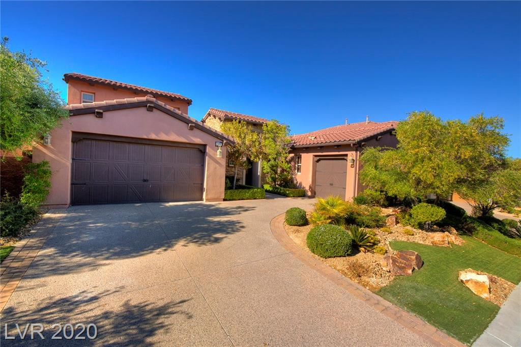 Spectacular Single Story with courtyard & huge lot in the gated community of Bella Fiore in Lake Las Vegas! Grand entry foyer flows to formal living and dining room. Hardwood & tile flooring throughout.Gourmet kitchen with large breakfast bar,granite counters & butler's pantry.Family room with fireplace & mountain views.Master with sitting area,walk in closet & spa inspired en suite.Casita with full bath & partial Strip view.Park inspired backyard with paver walkway,patios,fire pit & VIEWS!