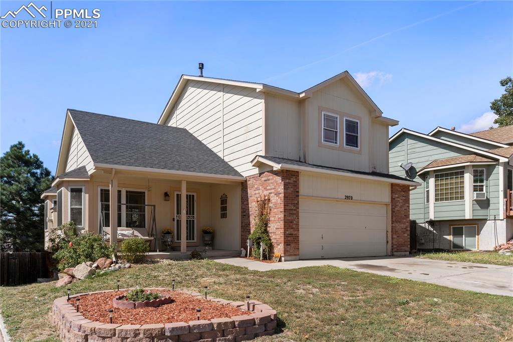 Great home located in the Powers Corridor! View of the MOUNTAINS, Easy Acess to Schreivier AFB, and many more amenities.  If you are looking for a great place this is it.  Large Bedrooms! Reading nooks in 2 of the bedroom windows and views from pikes peak from the master bedroom.  4 bedrooms and 4 baths open floor plan and an amazing walkout basement make this house ideal for a growing family and those who like to entertain. Easily turn the basement into a mother-in-law suite.  **Plus** the basement has a bonus room with a window, ready to become your new office, or add a closet and it's bedroom number 5.  The walkout basement is a major plus and since the house is wired for a hot tub you can just imagine how nice it would be to walk out of your basement and into the hot tub's soothing waters.  With a few upgrades and minor repairs, this house will be the envy of, and respite for your friends and family.  Great days are just ahead and memories are soon to be made in this house, it has tons of potential.  Home is sold As is.  Don't miss out on this opportunity.  Open House Friday 9/23 and Saturday 9/24 from 12:00 - 3:00 p.m.
