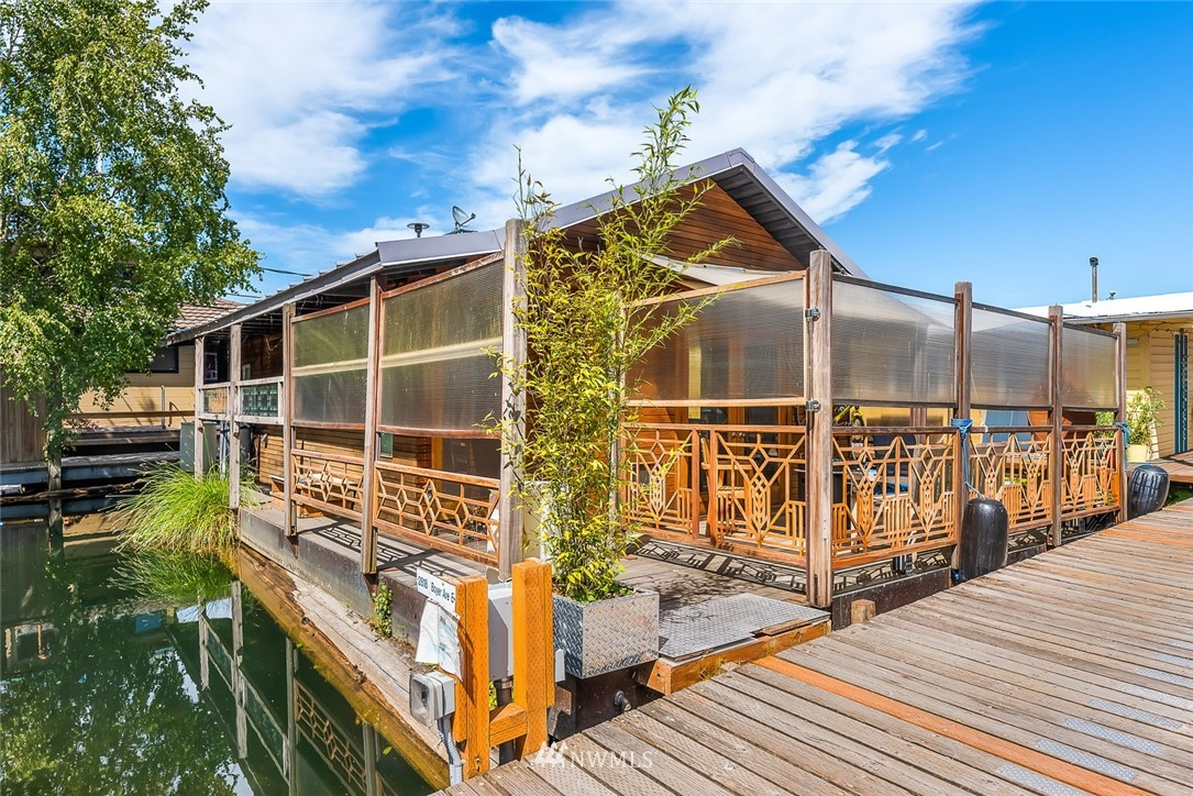 """This fantastic remodeled floating hideaway is an incredible place to call home. Light reflects off the water & dances on the soaring ceilings & warm wooden finishes.  Beautiful surfaces, bedroom + sleeping loft, gorgeous bath, upscale appliances, & double glass doors that open up to a privacy fenced deck which is the perfect floating """"yard"""". AND! It has AC! In an extremely private location on Portage Bay's Gold Coast, near the Yacht Clubs, this spot offers the Portage Bay Loop & Little Lago just to name a couple perks. Located conveniently near UW & Children's Hospital, it is an easy commute via I-5, 520, or city side streets.  Stroll down to the end of the dock & take in Opening Boat Day or launch your kayak and go be in it. Parking, too!"""