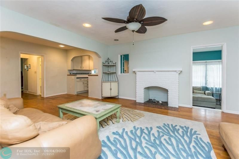 Not a typo!  2 blocks to Las Olas for under $600K.  This charming 3/2 casa offers a unique opportunity to the buyer yearning for the pedestrian lifestyle.  Take a short stroll to all the vibrant activity on the world famous Las Olas Bld.  It has plenty of upgrades but still offers the charisma of old Florida including the original Dade county pine flooring.  This delightful home has a split layout with 2 beds and jack n jill bath on one side with good sized master boasting soaring wood beamed ceilings in the rear.   Both baths are updated as is the kitchen with newer cabinetry, countertops and appliances.  There is a bonus room ideal as an office.  Low maintenance yard with separate concrete structure housing the washer/dryer and providing storage. Gas stove and tankless hot water heater.