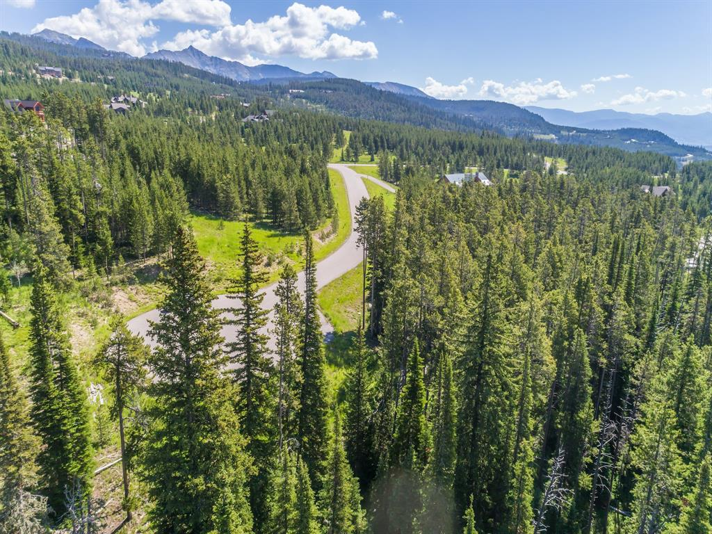 This three quarter of an acre lot is in a really neat location tucked into the trees off the end of a cul.de.sac right between Big Sky and Moonlight ski areas.   Lone Mountain, in all of it's grandeur, as well as Andesite Mountain, with all of the skiers (in the winter, of course), are your views from this somewhat secret spot.